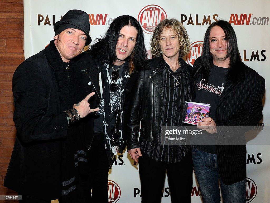 Musicians <a gi-track='captionPersonalityLinkClicked' href=/galleries/search?phrase=Michael+Ellis&family=editorial&specificpeople=214128 ng-click='$event.stopPropagation()'>Michael Ellis</a>, Todd Kerns, Rob Cournoyer and Brent Muscat of the rock band Sin City Sinners arrive at the 28th annual Adult Video News Awards Show at the Palms Casino Resort January 8, 2011 in Las Vegas, Nevada.