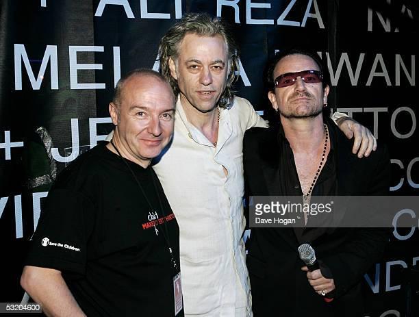 Musicians Midge Ure Sir Bob Geldof and Bono of U2 are seen backstage following the Live 8 Edinburgh concert at Murrayfield Stadium on July 6 2005 in...