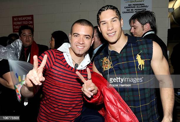 Musicians Miguel Ignacio Mendoza and Jesus Alberto Miranda Perez of Chino y Nacho pose backstage during the 11th annual Latin GRAMMY Awards at the...