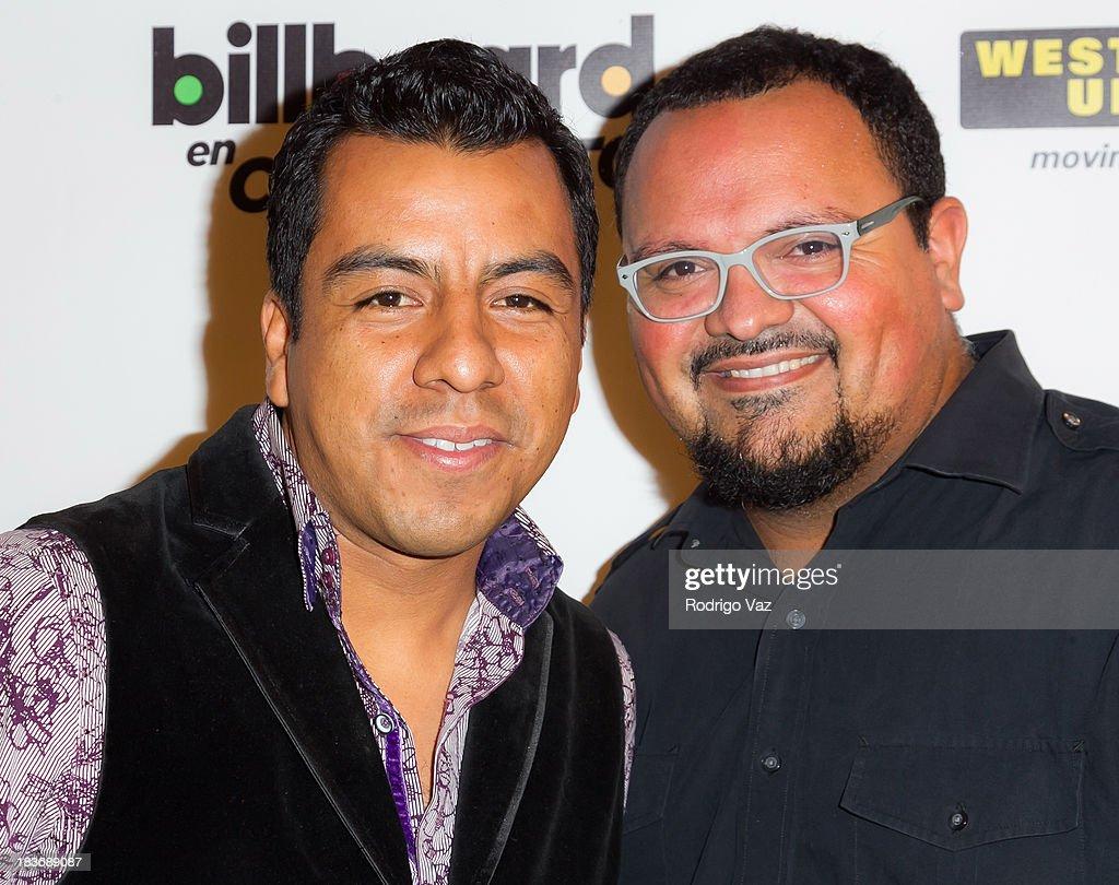 Musicians Miguel Ramirez (L) and Jose Carlos of La Santa Cecilia attend Billboard In Concert Series presents Calibre 50 at The Conga Room at L.A. Live on October 8, 2013 in Los Angeles, California.