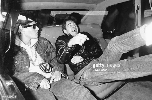 Musicians Mike D and Adam Yauch members of the band 'Beastie Boys' sitting in the back of car as they leave the Kensington Hilton Hotel London May...