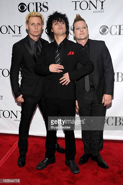 Musicians Mike Dirnt Billie Joe Armstrong and Tre Cool of Green Day attend the 64th Annual Tony Awards at Radio City Music Hall on June 13 2010 in...
