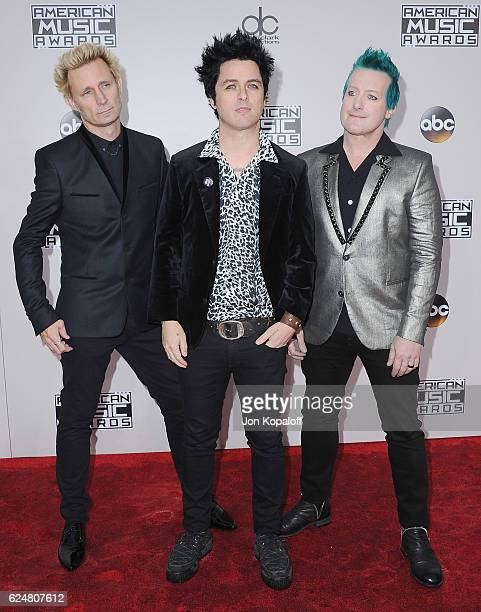 Musicians Mike Dirnt Billie Joe Armstrong and Tre Cool of Green Day arrive at the 2016 American Music Awards at Microsoft Theater on November 20 2016...