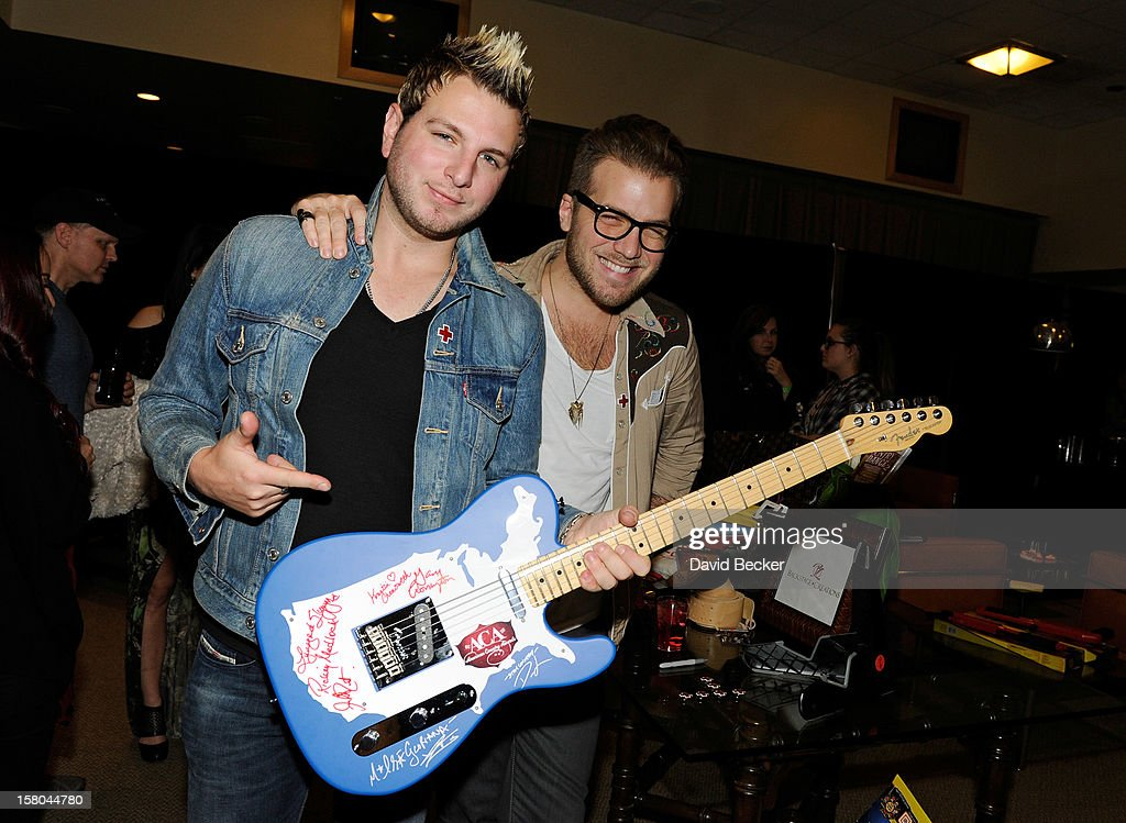 Musicians Mike Gossin (L) and Tom Gossin of Gloriana attend the Backstage Creations Celebrity Retreat at 2012 American Country Awards at the Mandalay Bay Events Center on December 9, 2012 in Las Vegas, Nevada.