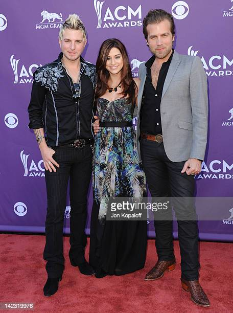 Musicians Mike Gossin Rachel Reinert and Tom Gossin of Gloriana arrive at the 47th Annual Academy Of Country Music Awards held at the MGM Grand...