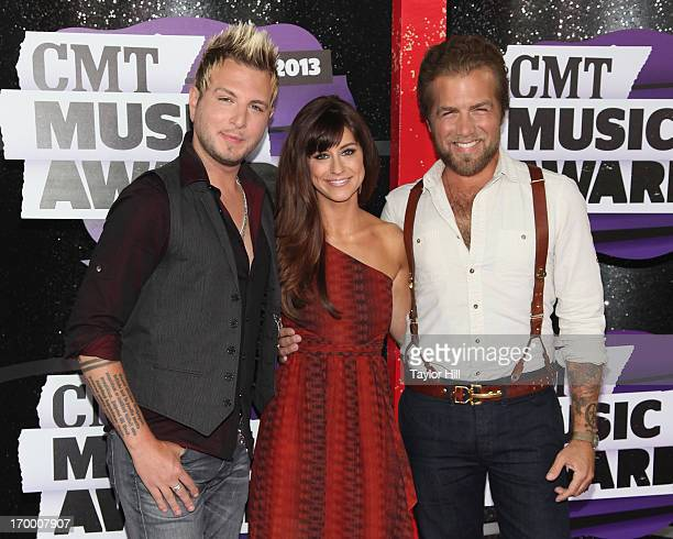 Musicians Mike Gossin Rachel Reinert and Tom Gossin of Gloriana the 2013 CMT Music awards at the Bridgestone Arena on June 5 2013 in Nashville...