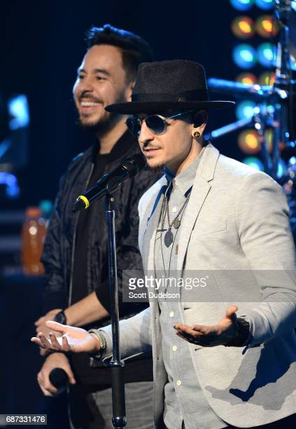 Musicians Mike Shinoda and Chester Bennington of Linkin Park perform onstage during the band's 'One More Light' album release party at the...