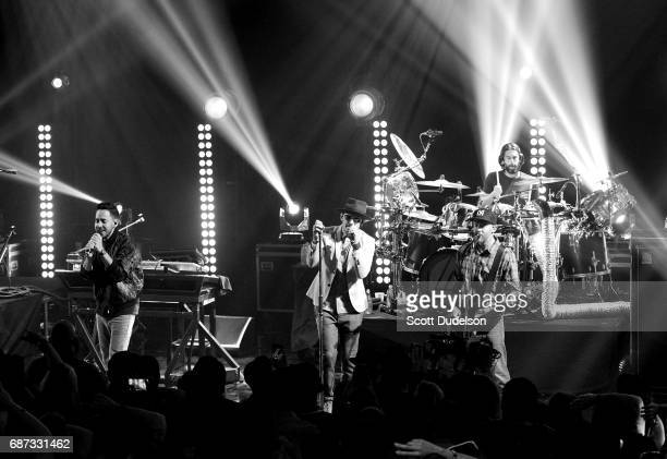 Musicians Mike Shinoda Chester Bennington Rob Bourdon and Dave Farrell of Linkin Park perform onstage during the band's 'One More Light' album...