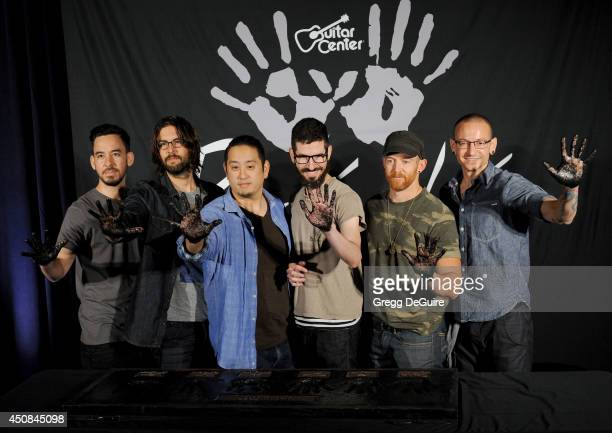 Musicians Mike Shinoda Rob Bourdon Joe Hahn Brad Delson Dave 'Phoenix' Farrell and Chester Bennington of Linkin Park are inducted into the Rockwalk...