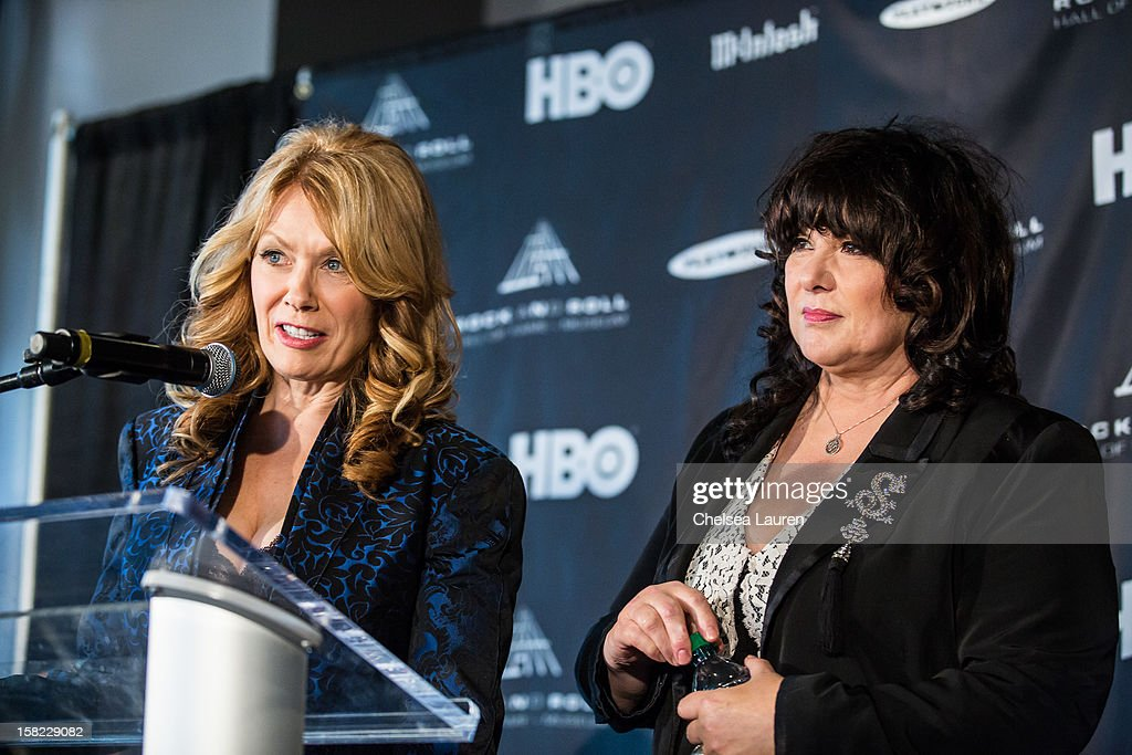 Musicians Nancy Wilson (L) and Ann Wilson of Heart attend the Rock & Roll Hall of Fame 2013 Inductee Press Conference at Nokia Theatre L.A. Live on December 11, 2012 in Los Angeles, California.