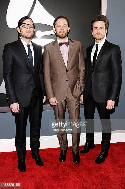Musicians Nathan Followill Caleb Followill and Jared Followill of the band Kings of Leon arrive at the 54th Annual GRAMMY Awards held at Staples...