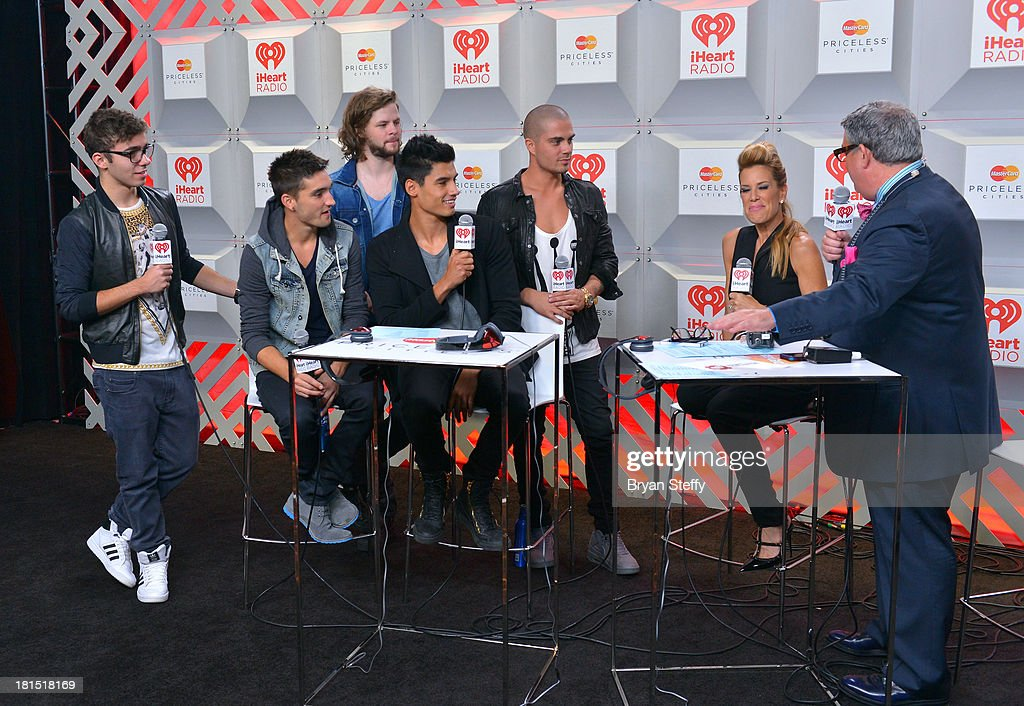 Musicians Nathan Sykes, Tom Parker, Jay McGuiness, Siva Kaneswaran and Max George of The Wanted speak with Ellen K and Elvis Duran during the iHeartRadio Music Festival at the MGM Grand Garden Arena on September 21, 2013 in Las Vegas, Nevada.
