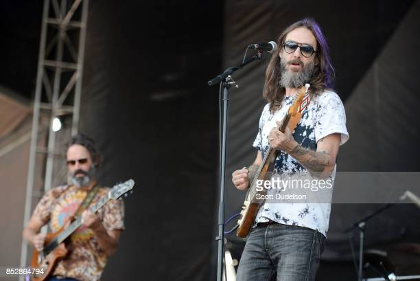 Musicians Neal Casal and Chris Robinson of The Black Crowes and Chris Robinson Brotherhood perform onstage during the Bourbon Beyond Festival at...