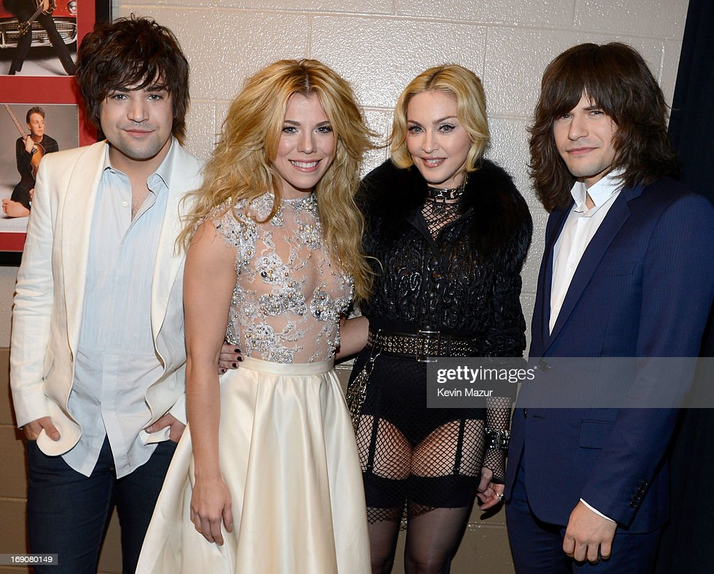 Musicians Neil Perry and <a gi-track='captionPersonalityLinkClicked' href=/galleries/search?phrase=Kimberly+Perry&family=editorial&specificpeople=6718325 ng-click='$event.stopPropagation()'>Kimberly Perry</a> of The Band Perry, singer <a gi-track='captionPersonalityLinkClicked' href=/galleries/search?phrase=Madonna+-+Singer&family=editorial&specificpeople=156408 ng-click='$event.stopPropagation()'>Madonna</a> and musician <a gi-track='captionPersonalityLinkClicked' href=/galleries/search?phrase=Reid+Perry&family=editorial&specificpeople=6718326 ng-click='$event.stopPropagation()'>Reid Perry</a> of The Band Perry attend the 2013 Billboard Music Awards at the MGM Grand Garden Arena on May 19, 2013 in Las Vegas, Nevada.