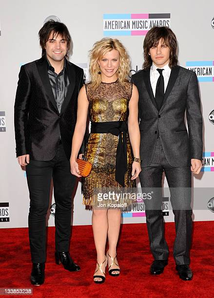 Musicians Neil Perry Kimberly Perry and Reid Perry of The Band Perry arrive at the 2011 American Music Awards held at Nokia Theatre LA Live on...