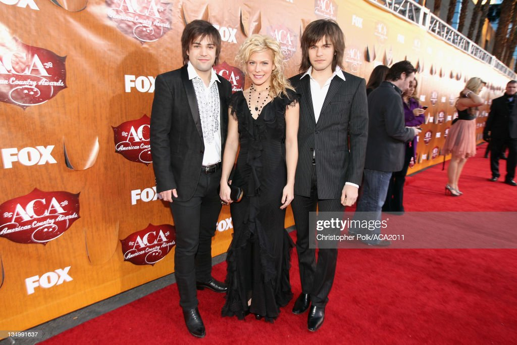 Musicians Neil Perry, <a gi-track='captionPersonalityLinkClicked' href=/galleries/search?phrase=Kimberly+Perry&family=editorial&specificpeople=6718325 ng-click='$event.stopPropagation()'>Kimberly Perry</a> and <a gi-track='captionPersonalityLinkClicked' href=/galleries/search?phrase=Reid+Perry&family=editorial&specificpeople=6718326 ng-click='$event.stopPropagation()'>Reid Perry</a> of The Band Perry arrive at the American Country Awards 2011 at the MGM Grand Garden Arena on December 5, 2011 in Las Vegas, Nevada.
