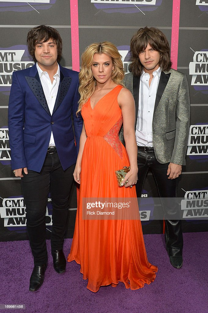 Musicians Neil Perry, Kimberly Perry and Reid Perry of The Band Perry attend the 2013 CMT Music awards at the Bridgestone Arena on June 5, 2013 in Nashville, Tennessee.