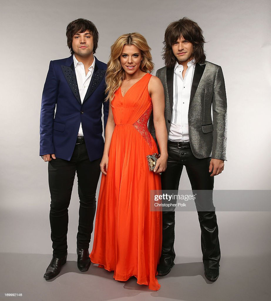 Musicians Neil Perry, Kimberly Perry and Reid Perry of The Band Perry pose at the Wonderwall portrait studio during the 2013 CMT Music Awards at Bridgestone Arena on June 5, 2013 in Nashville, Tennessee.