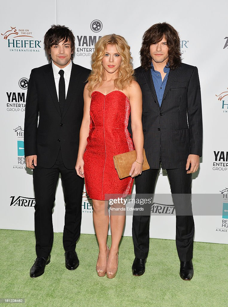 Musicians Neil Perry, Kimberly Perry and Reid Perry of The Band Perry arrive at the 2nd Annual Beyond Hunger: A Place At The Table Benefit Honoring Susan Sarandon at Montage Beverly Hills on September 19, 2013 in Beverly Hills, California.