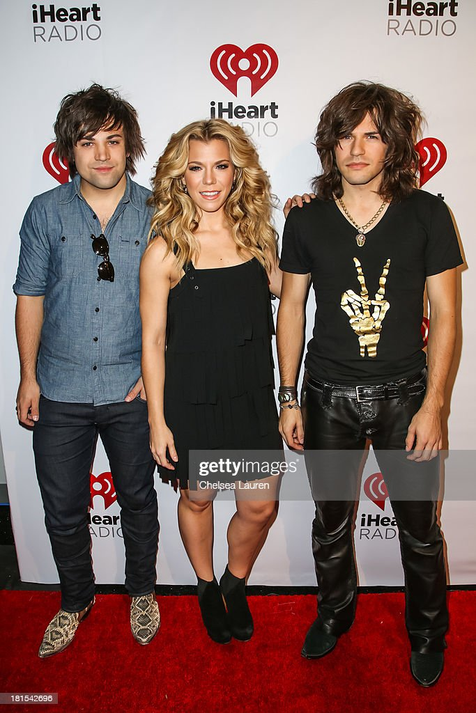 Musicians Neil Perry, <a gi-track='captionPersonalityLinkClicked' href=/galleries/search?phrase=Kimberly+Perry&family=editorial&specificpeople=6718325 ng-click='$event.stopPropagation()'>Kimberly Perry</a>, and <a gi-track='captionPersonalityLinkClicked' href=/galleries/search?phrase=Reid+Perry&family=editorial&specificpeople=6718326 ng-click='$event.stopPropagation()'>Reid Perry</a> of The Band Perry pose backstage at The Village during the iHeartRadio music festival on September 21, 2013 in Las Vegas, Nevada.