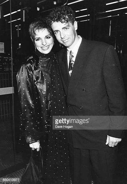 Musicians Neil Tennant of the 'Pet Shop Boys' and Liza Minnelli at an event together August 1989
