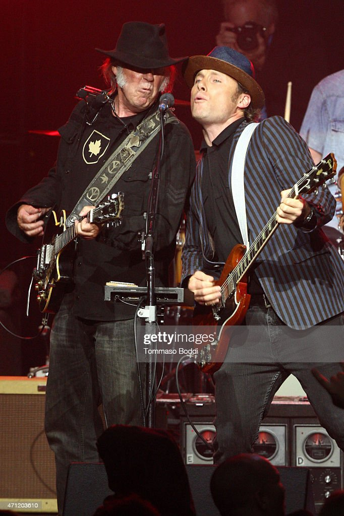 Musicians Neil Young (L) and Chris Stills perform on stage during the 3rd Light Up the Blues Concert to benefit Autism Speaks held at the Pantages Theatre on April 25, 2015 in Hollywood, California.