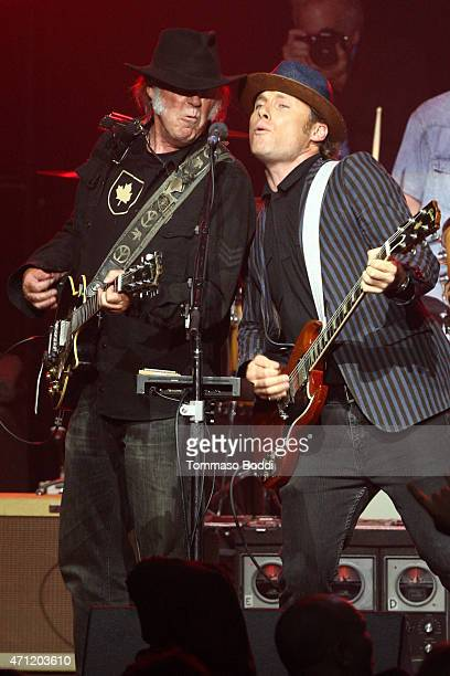 Musicians Neil Young and Chris Stills perform on stage during the 3rd Light Up the Blues Concert to benefit Autism Speaks held at the Pantages...