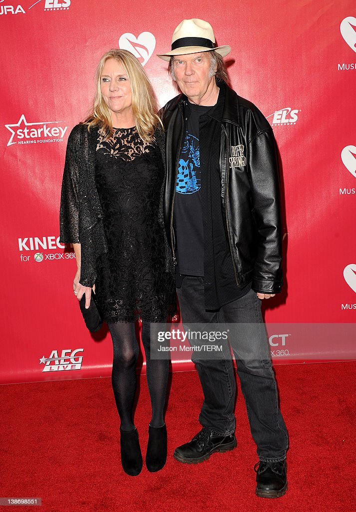 Musicians Neil Young (R) and Pegi Young arrive at the 2012 MusiCares Person of the Year Tribute to Paul McCartney held at the Los Angeles Convention Center on February 10, 2012 in Los Angeles, California.