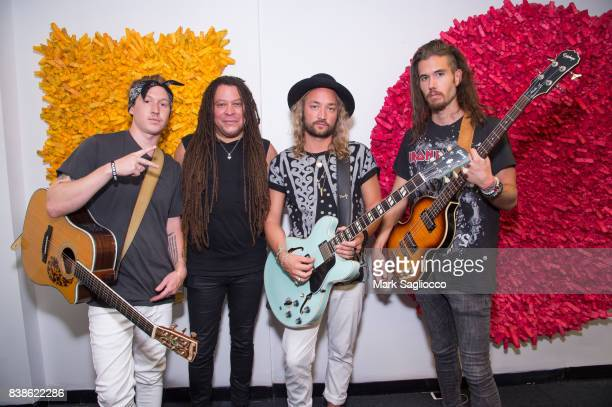 Musicians Neils Svennsson Aaron A Brooks Jay Sheppard and Marcus Svensson of 'The Family Portrait' attend the Contemporary Figurative Expressionist...