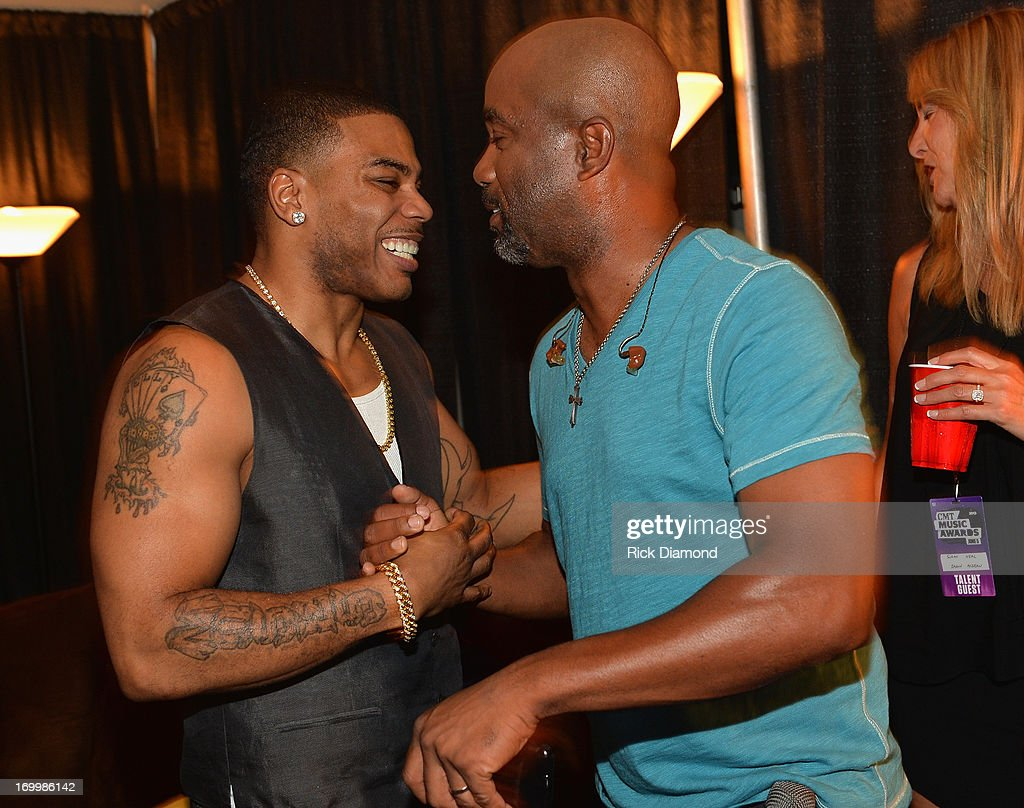 Musicians <a gi-track='captionPersonalityLinkClicked' href=/galleries/search?phrase=Nelly+-+Rapper&family=editorial&specificpeople=11499081 ng-click='$event.stopPropagation()'>Nelly</a> and <a gi-track='captionPersonalityLinkClicked' href=/galleries/search?phrase=Darius+Rucker&family=editorial&specificpeople=215161 ng-click='$event.stopPropagation()'>Darius Rucker</a> attend the 2013 CMT Music awards at the Bridgestone Arena on June 5, 2013 in Nashville, Tennessee.