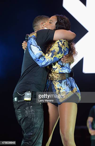 Musicians Nelly and Kelly Rowland perform onstage during Day 1 of Jazz In The Gardens at Sun Life Stadium on March 15 2014 in Miami Gardens Florida