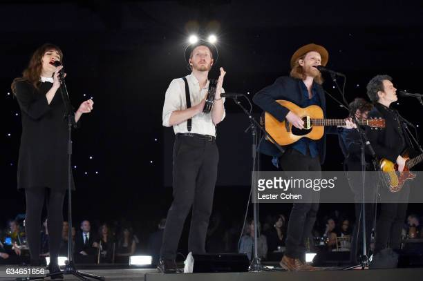Musicians Neyla Pekarek Jeremiah Caleb Fraites and Wesley Schultz of The Lumineers perform onstage during MusiCares Person of the Year honoring Tom...