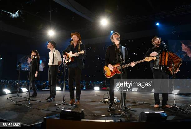 Musicians Neyla Pekarek Jeremiah Caleb Fraites Wesley Schultz Byron Isaacs and Stelth Ulvang of The Lumineers perform onstage during MusiCares Person...