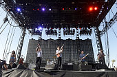 Musicians Neyla Pekarek Jeremiah Fraites Wesley Schultz Stelth Ulvang and Ben Wahamaki of the band The Lumineers pose backstage during day 3 of the...