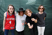 Musicians Nick Bockrath Jared Champion Matt Shultz and Matthan Minster of Cage the Elephant pose backstage during day 2 of the Firefly Music Festival...