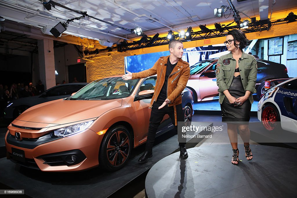 Musicians Nick Jonas and Demi Lovato pose with the 2017 Honda Civic Sedan at the Honda Civic Tour Artists Announcement and Honda Civic North America Launch Event at the Garage on March 22, 2016 in New York City.