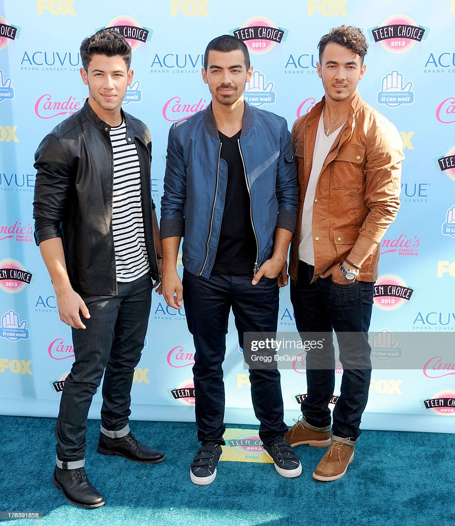 Musicians Nick Jonas, Joe Jonas and Kevin Jonas arrive at the 2013 Teen Choice Awards at Gibson Amphitheatre on August 11, 2013 in Universal City, California.