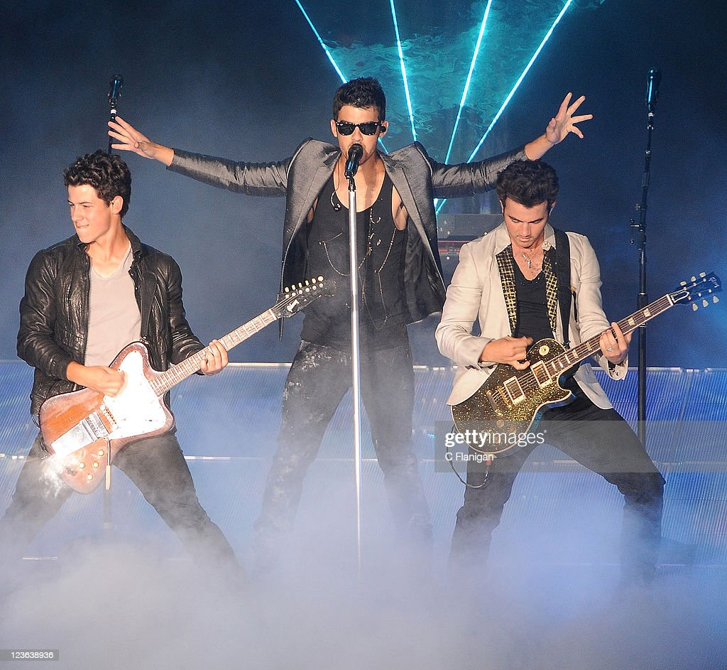 Musicians Nick Jonas Joe Jonas and Kevin Jonas of The Jonas Brothers perform at Shoreline Amphitheatre on September 18 2010 in Mountain View...