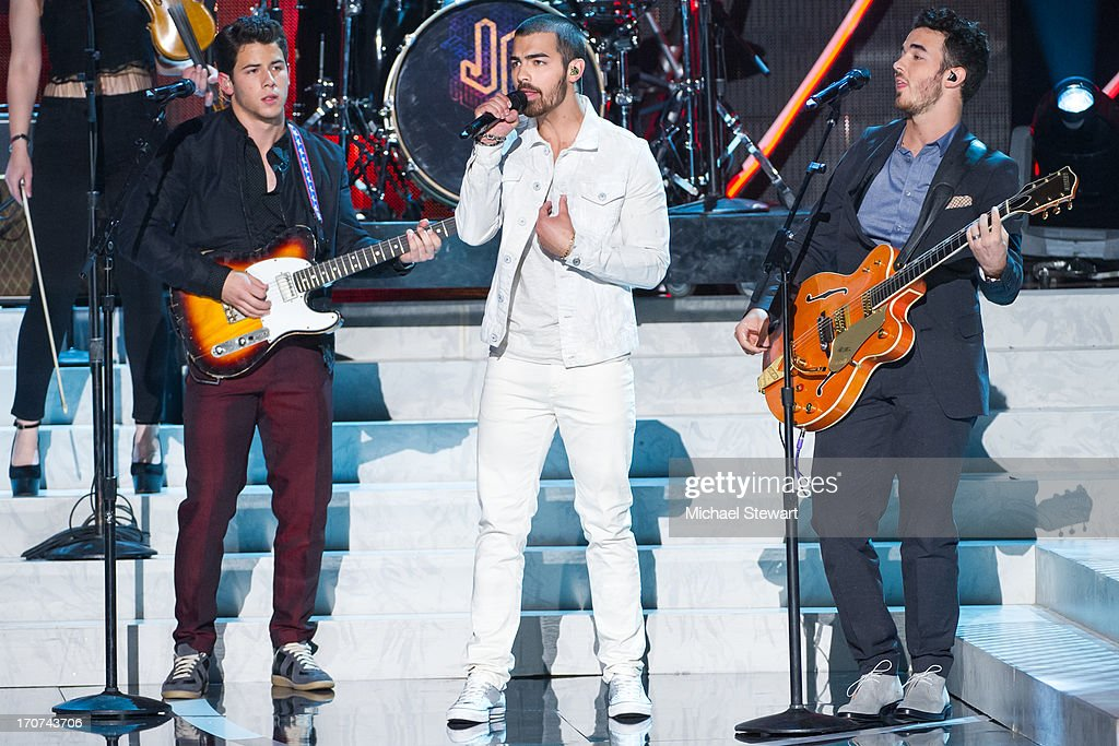 Musicians <a gi-track='captionPersonalityLinkClicked' href=/galleries/search?phrase=Nick+Jonas&family=editorial&specificpeople=842713 ng-click='$event.stopPropagation()'>Nick Jonas</a>, <a gi-track='captionPersonalityLinkClicked' href=/galleries/search?phrase=Joe+Jonas&family=editorial&specificpeople=842712 ng-click='$event.stopPropagation()'>Joe Jonas</a> and <a gi-track='captionPersonalityLinkClicked' href=/galleries/search?phrase=Kevin+Jonas&family=editorial&specificpeople=709547 ng-click='$event.stopPropagation()'>Kevin Jonas</a> of the Jonas Brothers perform during the 2013 Miss USA pageant at PH Live at Planet Hollywood Resort & Casino on June 16, 2013 in Las Vegas, Nevada.