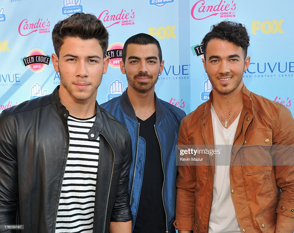 Musicians Nick Jonas Joe Jonas and Kevin Jonas of the Jonas Brothers attend the 2013 Teen Choice Awards at Gibson Amphitheatre on August 11 2013 in...