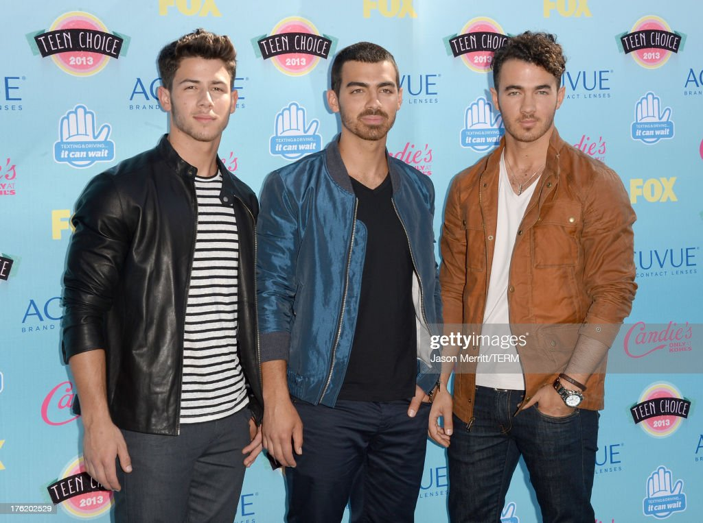 Musicians Nick Jonas Joe Jonas and Kevin Jonas of the Jonas Brothers attend the Teen Choice Awards 2013 at Gibson Amphitheatre on August 11 2013 in...