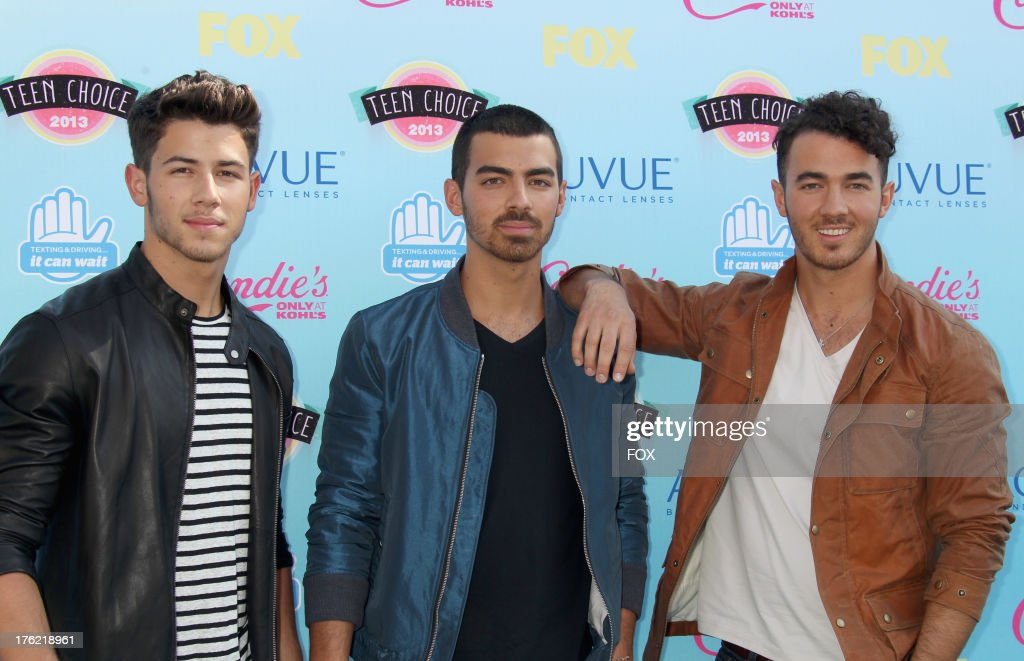 Musicians <a gi-track='captionPersonalityLinkClicked' href=/galleries/search?phrase=Nick+Jonas&family=editorial&specificpeople=842713 ng-click='$event.stopPropagation()'>Nick Jonas</a>, <a gi-track='captionPersonalityLinkClicked' href=/galleries/search?phrase=Joe+Jonas&family=editorial&specificpeople=842712 ng-click='$event.stopPropagation()'>Joe Jonas</a>, and <a gi-track='captionPersonalityLinkClicked' href=/galleries/search?phrase=Kevin+Jonas&family=editorial&specificpeople=709547 ng-click='$event.stopPropagation()'>Kevin Jonas</a> of the Jonas Brothers arrive at the Fox Teen Choice Awards 2013 held at the Gibson Amphitheatre on August 11, 2013 in Los Angeles, California.