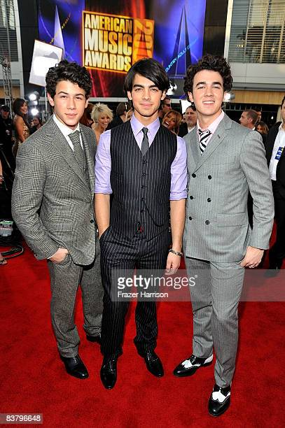 Musicians Nick Jonas Joe Jonas and Kevin Jonas of the Jonas Brothers arrives at the 2008 American Music Awards held at Nokia Theatre LA LIVE on...