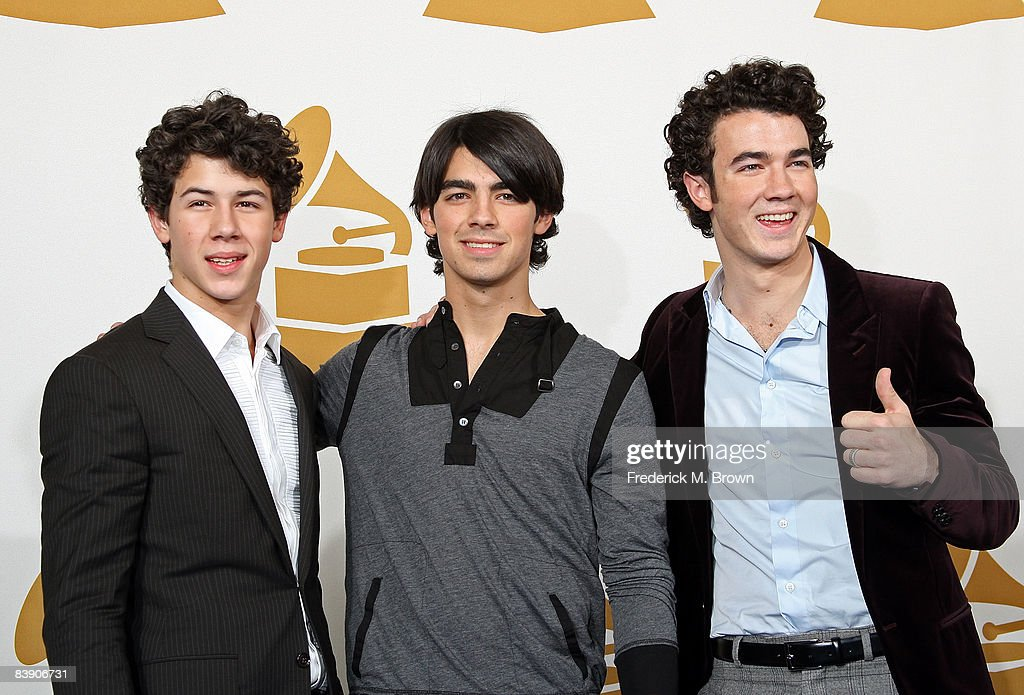 Musicians Nick Jonas Joe Jonas and Kevin Jonas of The Jonas Brothers pose in the press room during the Grammy Nominations concert live held at the...
