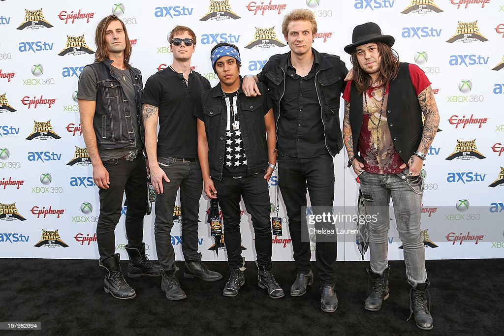 Musicians Nick McMahan, Harry MacDonald, Josh Mouser, Austin Held and Nicholas Wiggins of Girl on Fire arrive at the 5th Annual Revolver Golden Gods awards show at Club Nokia on May 2, 2013 in Los Angeles, California.