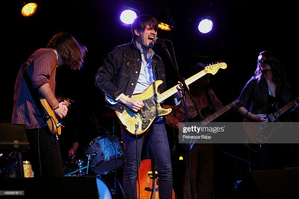Musicians Nick Stratton, Jamie Douglass (on drums), Josh Norton, Jason Chesney and Katie Stratton of Beeswax perform onstage at El Cid on November 15, 2013 in Los Angeles, California.