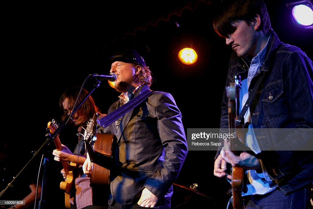 Musicians Nick Stratton, Paul Chesne and Josh Norton of Beeswax perform onstage at El Cid on November 15, 2013 in Los Angeles, California.