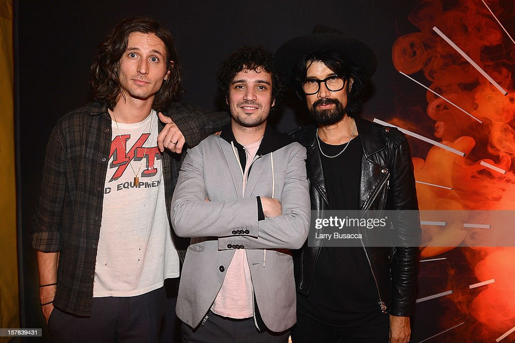 Musicians <a gi-track='captionPersonalityLinkClicked' href=/galleries/search?phrase=Nick+Valensi&family=editorial&specificpeople=651473 ng-click='$event.stopPropagation()'>Nick Valensi</a> and <a gi-track='captionPersonalityLinkClicked' href=/galleries/search?phrase=Fabrizio+Moretti+-+Drummer&family=editorial&specificpeople=651471 ng-click='$event.stopPropagation()'>Fabrizio Moretti</a> of The Strokes with DJ Miles Hendrix attend the Carrera Cocktail Party hosted by AD Oasis at The Raleigh on December 6, 2012 in Miami, Florida.