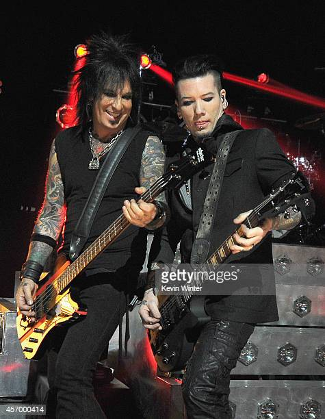 Musicians Nikki Sixx and DJ Ashba of Sixx AM perform for iHeartRadio Live at The iHeartRadio Theater Los Angeles on October 7 2014 in Burbank...
