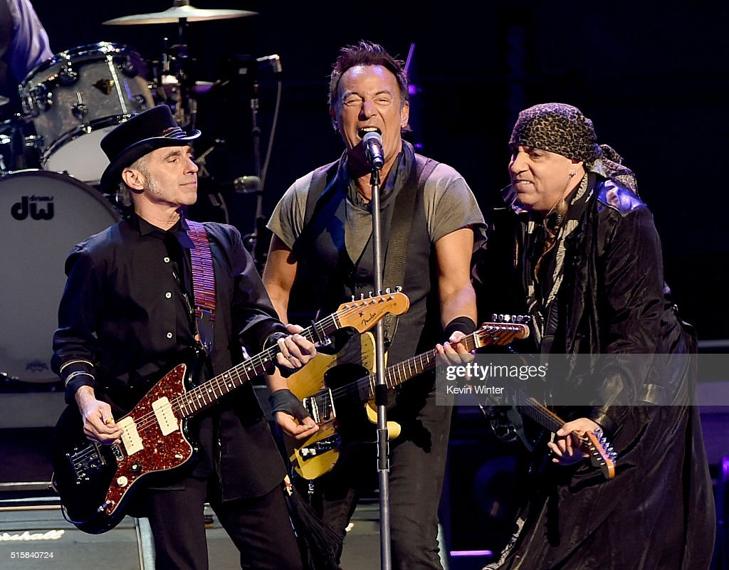 Musicians Nils Lofgren, Bruce Springsteen and Stevie Van Zandt perform with Bruce Springsteen and the E Street Band at the Los Angeles Sports Arena on March 15, 2016 in Los Angeles, California.